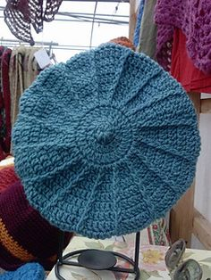 a beret I worked up last week, it took me about 2 hours. I used Vanna's Choice yarn