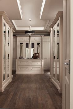 master closet cabinetry, some mirrored doors, wood floors