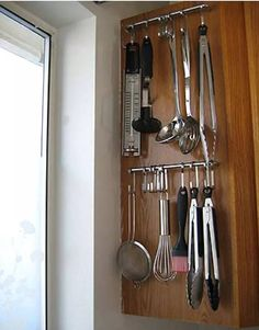 If you have narrow cabinets, attach handles to the side and use hooks to hang whisks, spoons, and other cooking tools. Bonus points if you can store them near the stove, so you'll always be ready to save your pancakes from burning. See more at Not Martha »   - HouseBeautiful.com