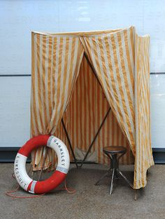 Collapsible Victorian beach hut. Great colours. Pockets at the bottom for pebbles or shoes? Pop-up changing room or art installation? A rare find.  origin: uk  year: 1900