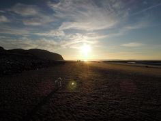 Walking the Dog on the Beach as the sun sets ...