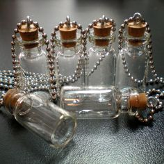 5 Small Glass Bottles with Cork loop and Ball von BottlesNThings
