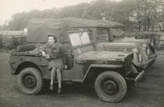 This photo shows Joan Rogers sitting in the jeep she used to pass a driving test. She found the jeep 'great fun'. She lived in London during WWII, serving in the Royal Army Pay Corp before being selected for officer training at the Women's Royal Army Corps. The website TheMemoryProject shares her story of living through the bombing of London.  http://www.thememoryproject.com/stories/1009:joan-mary-rogers/