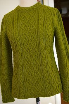 Such beautiful cables!! This is the St. Brigid Sweater by Alice Starmore, published in Aran Knitting. See another lovely example of this sweater at http://www.flickr.com/photos/23496596@N06/2506546200/lightbox/