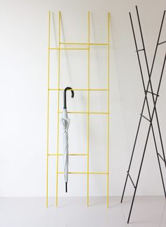 Two ladders are joined by hidden hinges to create this adaptable slimline coat rack by Taiwanese designer Yenwen Tseng.
