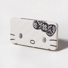 We ♥ the lil' tweed bow on this Hello Kitty Hardcase Wallet