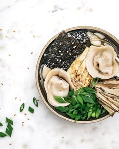 Vegan Dumpling and Rice Cake Soup (Tteokguk) - girl meets radish Rice Recipes, Asian Recipes, Vegetarian Recipes, Ethnic Recipes, Vegan Soups, Vegan Dumplings, Dumplings For Soup, Korean Rice Cake Soup, Mushroom Broth