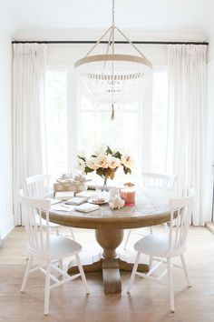Great White Dining Room with beaded chandelier. Christmas Kitchen Table The post White Dining Room with beaded chandelier. Christmas Kitchen Table… appeared first on D . Round Dining Table Modern, Dining Table Design, Circle Dining Table, White Round Kitchen Table, Round Pedestal Dining Table, Kitchen White, Small Dining, White Dining Rooms, Kitchen Table Light