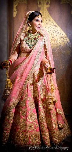 Real Indian Weddings - Sanam and Suhel | WedMeGood | Beautiful Bride in a Light Pink Bridal Lehenga with Gold Dabka Work and a Polki, Diamond, Emerald and Ruby Necklace #wedmegood #indianwedding #indianbride #lehenga #pink #gold #dabka