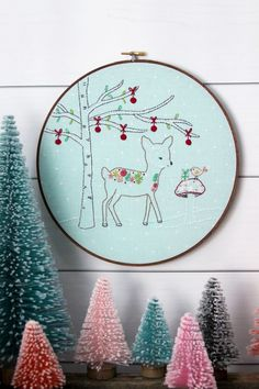 This Winter Woodland Christmas Embroidery pattern is all decorated with a sweet winter scene with this floral deer and her little birdie friend!