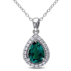 This pretty teardrop necklace from the Miadora Collection features a pear-cut created emerald surrounded by white sapphires stone. This shimmering pendant is hung on a cable chain and is crafted of fine sterling silver.