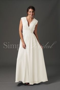 Wedding Dress by SimplyBridal. Slip on the Raphaela gown and let yourself be bewitching. This graceful floor-length dress has a classically stunning A-line silhouette. The pleated chiffon along the v-neckline and waist are slimming, while the full skirts add a formal elegance. In both . USD $109.99
