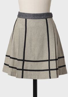 Wonderland Skirt By Knitted Dove  74.99 at shopruche.com. This chic black and sage tweed skirt is perfected with black chalk-stripe details and subtle knife pleating. Finished with a hidden side zipper and hook closure, this wool and cotton blend fully lined skirt looks lovely paired with tights on chilly...