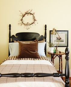 velvet dark brown pillow, bold brown and cream stripe w/black painted bed, bamboo table, antique brass lamp
