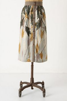 Anthropologie Flurried Plumes Midi.. Love that skirts are coming back in style at half-calf length.