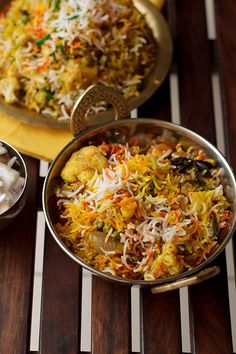 Hyderabadi Vegetable Biryani recipe is a traditional and popular recipe served across all joints, stalls in India. Also known as Tahiri or Tarkari Biryani. Indian Food Recipes, Vegetarian Recipes, Cooking Recipes, Ethnic Recipes, Rice Recipes, Cooking Tips, Arabic Recipes, Recipies, Hyderabadi Biryani Recipe