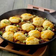 Your whole family will be digging into this hearty taco meat and bean mixture. The topping of corn bread and Cheddar cheese makes it especially delicious.
