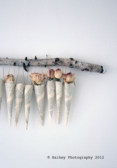book page cones and dried roses