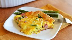 Ham, eggs and asparagus are what make this casserole hearty and delicious. It's quick to throw together and will be a family favorite!