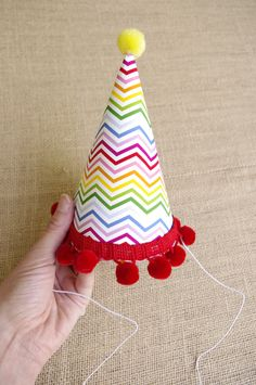 DIY Party Hats (with tutorial) - we love the pompom fringe!