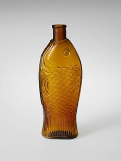 Bottle Free-blown molded amber glass 1850-1900 United States.