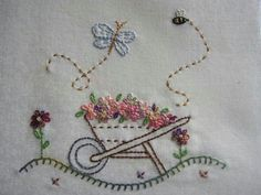 Wheelbarrow with flowers, bee, and butterfly