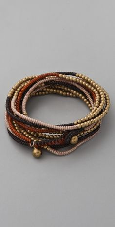 Triple-strand wrap bracelet, waxed linen thread & brass beads  - like the wrapping technique.  #handmade #jewelry