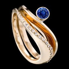 Covet and Grace sapphire rings are a stunning pair. Shown here in yellow gold with a carat blue sapphire in our Grace design stacked upon the Covet ring which features 21 pavé set diamonds. Modern Jewelry, Jewelry Art, Silver Jewelry, Jewelry Design, Jewelry Center, Fine Jewelry, Jewelry Making, Jewellery, The Sapphires