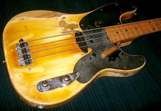 Supposably, the first Fender Precision bass guitar....unknown location....