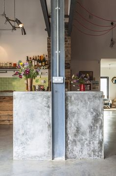 The concrete worktops by Derek Shaw match the floor. The exposed steel and…