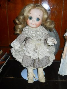 I found this Kestner googlie eye doll at a thrift store. She has a hairline crack on her face and is missing a hand but still gorgeous
