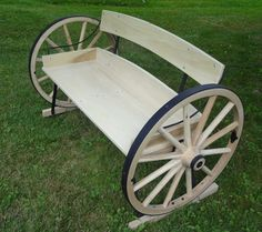 This is such a great idea for a bench. I love the way the wagon wheels look. It's such a creative use for such a beautiful piece of history.