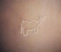 """Animal Necklaces by Make Pie Not War,  Uncovet    made from heavier wire for looks and durability.  Made from either sterling silver or 14k gold filled wire and chain. Plated clasp. Comes 16"""". Choose from: Elephant or horse, Silver or Gold."""