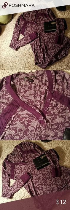 Almost Famous baseball shaped shirt size small Long sleeves,  deep v that buttons border that highlights v shaped neckline. Size small, material is thin and somewhat sheer. 55% cotton and 45% polyester. In excellent condition. Almost Famous Tops