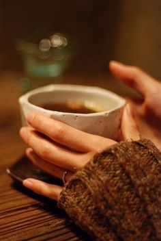 Cozy cup of coffee with an over-sized sweater. Winter warmth mmmm.