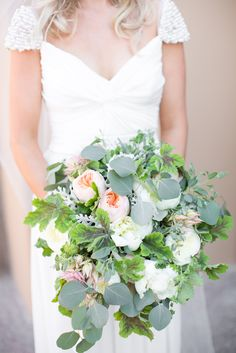 Pretty peonies and greens! View the full wedding here: http://thedailywedding.com/2015/11/20/romantic-floral-wedding-rachel-perry/
