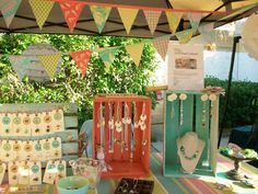 Wood crates and gorgeous color - very pretty craft booth! If I ever start selling crafts again I need to remember this!