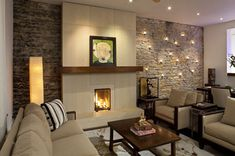 56 Clean and modern showcase fireplace design raised hearth wood mantle and stone