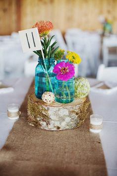 love the blue jars, wood slab and votives wrapped in jute.