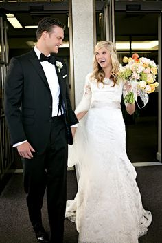 A fantastic modest wedding dress. Cream lace 3/4 sleeve overlay on top of a cream cap sleeve fit and flare gown.