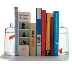 glass jar book ends. could be used as fish bowls or flower vases.
