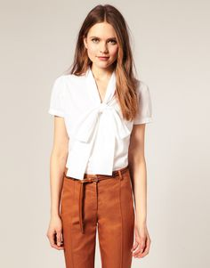 white blouse and camel pants