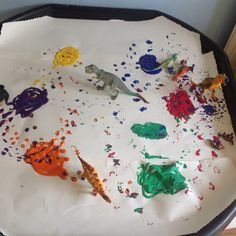 Painting with dinosaurs fun messy activity for children of all ages.