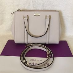 """⚜Kate Spade⚜Newbury Loden Small ✨Brand New With Tag and Bag, Guarantee Authentic✨ Available on Ⓜ️erc and Viinted for less   Size: Small•color: pebble Details: Satchel with snap closure and an adjustable, removable strap Dual interior slide pockets, two zipper, compartments, and interior zipper pocket Gold Kate Spade New York signature 8.2x10.9x4.7  drop length 4.3"""" handle  gold hardware kate spade Bags Satchels"""