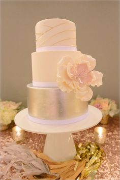 Silver gold and ivory modern wedding cake