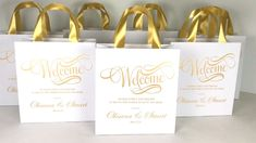 Elegant wedding welcome bags with Gold satin ribbon handles and names. Chic personalized Indian wedding gifts and favors for guests. #personalizedgifts #giftbags #weddingfavor #weddingwelcomebags #welcomebags #weddingfavorideas #weddingparty #weddingfavorideas #weddingparty #weddingfavour #weddingwelcome #indianwedding #elegantwedding #goldwedding #weddingbag