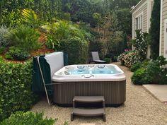 A secret garden escape surrounds our Jacuzzi J325 in Summerland, CA. www.gordonandgrant.com