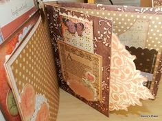 """These next two pages are also narrow, measuring 4 1/2 """" wide by 6"""" tall. I wanted to add a large tag between them using two die cuts, back..."""