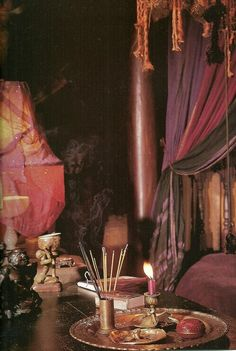 Soft and moody bohemian interior with pink drapes