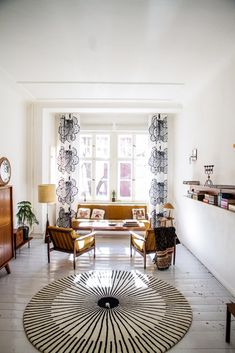 white living room with Verner Panton rug and scandinavian mid century furniture